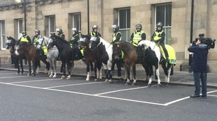 Police await the fans on derby day.