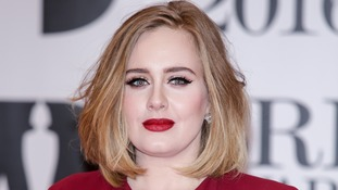 "Adele is said to be ""furious"" after private photos were stolen and leaked by hacker"