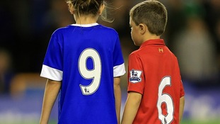 A young Everton and Liverpool fan pay tribute to the 96 people who died in the Hillsborough tragedy