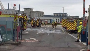 Fire crews dampening down after blaze in hanger at Norwich Airport