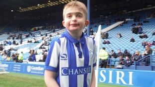 Boy, 10, defies doctors who said he may never walk and leads out Sheffield Wednesday