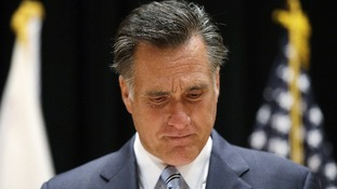 Republican presidential candidate Mitt Romney speaks to reporters about the secretly taped video