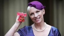 Musician Annie Lennox poses with her OBE which she received from Queen Elizabeth II at Buckingham Palace in London.