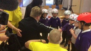 Handing out helmets