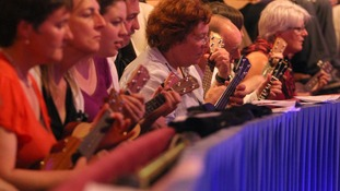 Members of the public play along with the Ukulele Orchestra of Great Britain, at the Royal Albert Hall, in Kensington, west London.
