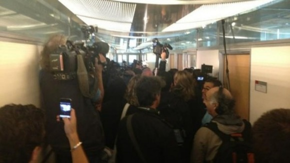 The media scrum ahead of the French court's decision