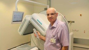 Mark Richardson, head of nuclear medicine at South Tees Hospitals NHS  Foundation Trust, tests out the new Siemens 'Symbia Evo' camera at The James Cook   University Hospital in Middlesbrough
