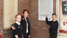 Elected Mayor Norma Redfearn with Deputy Young Mayor, Bethany Amer, and Lewis, of Christ Church School, who designed the logo for the trail