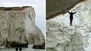 Reckless pair play dare on edge of crumbling 200ft high cliff