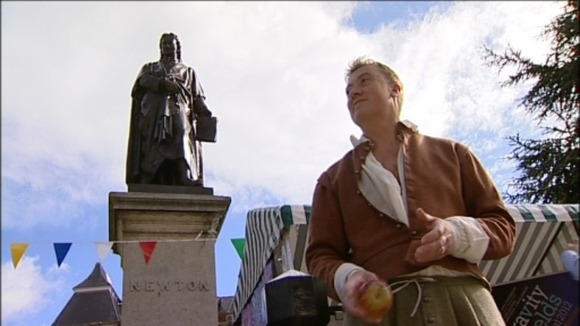 Sir Isaac Newton lookalike is watched by Sir Isaac's statue
