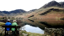 People take a break at Buttermere in the Lake District in Cumbria.
