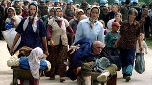 A group of Bosnian Muslims seeks refuge after fleeing Srebrenica