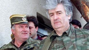 Bosnian Serb wartime leader Radovan Karadzic (R) and his general Ratko Mladic in Mountain Vlasic in April 1995.