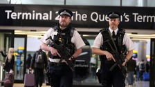 Armed police officers patrolling Heathrow
