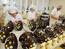Chocolatiers work on the hand-crafted chocolate Easter eggs and rabbits at Betty's in Harrogate