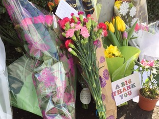 Tributes left to popular shopkeeper Asad Shah who was killed on Thursday