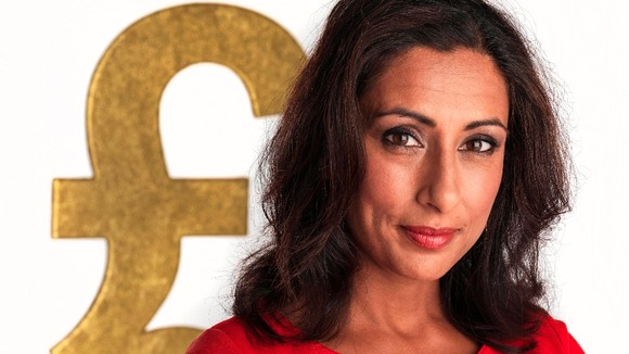Close Up of Saira Khan with huge pound sign in background
