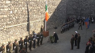 Irish President Michael D Higgins lays a wreath at the spot of the execution of 15 rebel leaders in the 1916 Rising