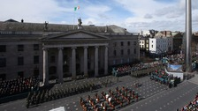 The largest military parade in the history of the state passes the GPO as part of the 1916 Easter Rising centenary commemorations in Dublin.