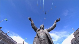 Military aircraft flying above the statue of Jim Larkin, a famed Irish socialist activist