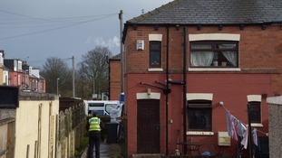 Police at a property in East Park Street