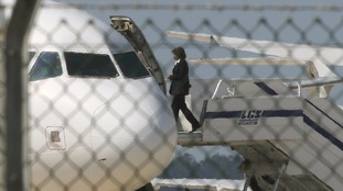 An official boards the hijacked Egyptair A320 Airbus at Larnaca Airport.