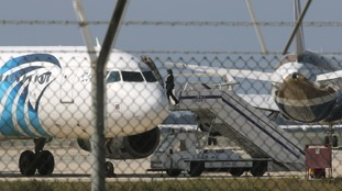 The official was photographed entering the plane from beyond the airfield fencing.