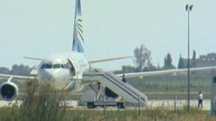 Other apparent crew members were seen leaving the aircraft by the stairs.