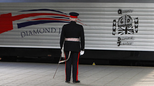 The train carrying Queen Elizabeth II and the Duke of Edinburgh arrives at Victoria Station in Manchester with a new Diamond Jubilee livery