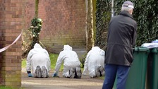 Police forensic officers search around Grangeway in Barnet, north London.