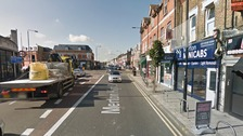 The teenager try to flee down Merton High Street