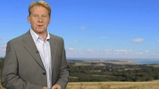 Simon Parkin in front of weather photo