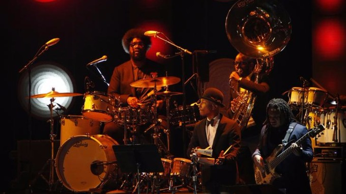 The Roots, pictured here with Pharrell Williams, were unable to perform