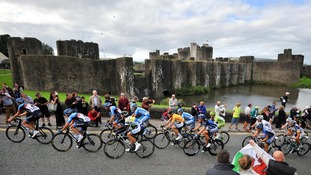 Riders make their way past Caerphilly Castle