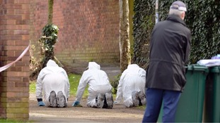 Forensic officers searching the area where Ali Nasrollahi was found collapsed