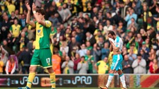 Newcastle United's Andros Townsend is left dejected after the final whistle as Norwich City's Timm Klose celebrates