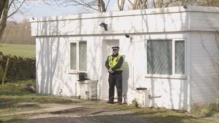 Police guard the house in Shelf near Halifax