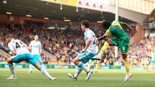 Norwich City's Dieumerci Mbokani (right) scores his side's second goal of the game during the Barclays Premier League match at Carrow Road, Norwich.