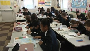 Pupils learning in the cramped mobile classrooms