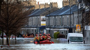 Rescue teams help people escape flooded homes in York in 2015