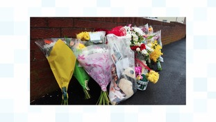 Floral tributes to James Wilson.