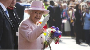 The Queen waves to crowds in Manchester
