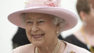 Queen smiles at crowds in Manchester