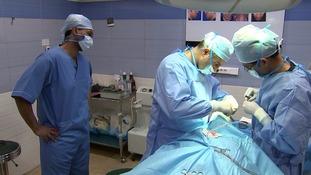 Rageh Omaar looks on as Dr Hamidreza Hosnani carries out a rhinoplasty procedure.