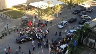 US ambassador's car surrounded by Chinese protesters