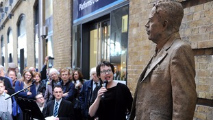 Sculptor Hazel Reeves stands next to her statue of railway engineer Sir Nigel Gresley