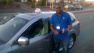 Taxi driver terrified as gang throw brick through window