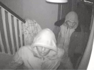 Chilling CCTV shows the men creeping around the home