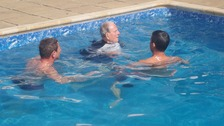 Verdun takes a dip with Roger his grandson, and Ian his son-in-law