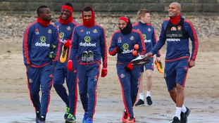 The team donned their gloves, hats and snoods for the wet training session